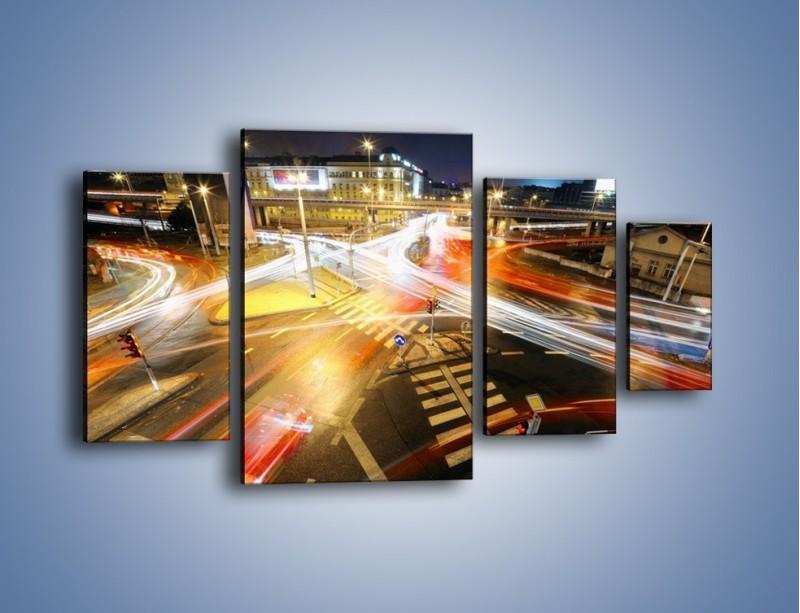 Obraz na płótnie – Światła samochodów w ruchu na skrzyżowaniu – czteroczęściowy AM279W4