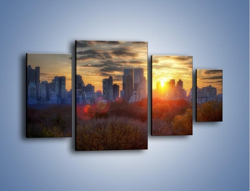 Obraz na płótnie – Wschód słońca nad miastem – czteroczęściowy AM318W4