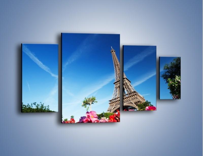 Obraz na płótnie – Wieża Eiffla pod błękitnym niebem – czteroczęściowy AM379W4