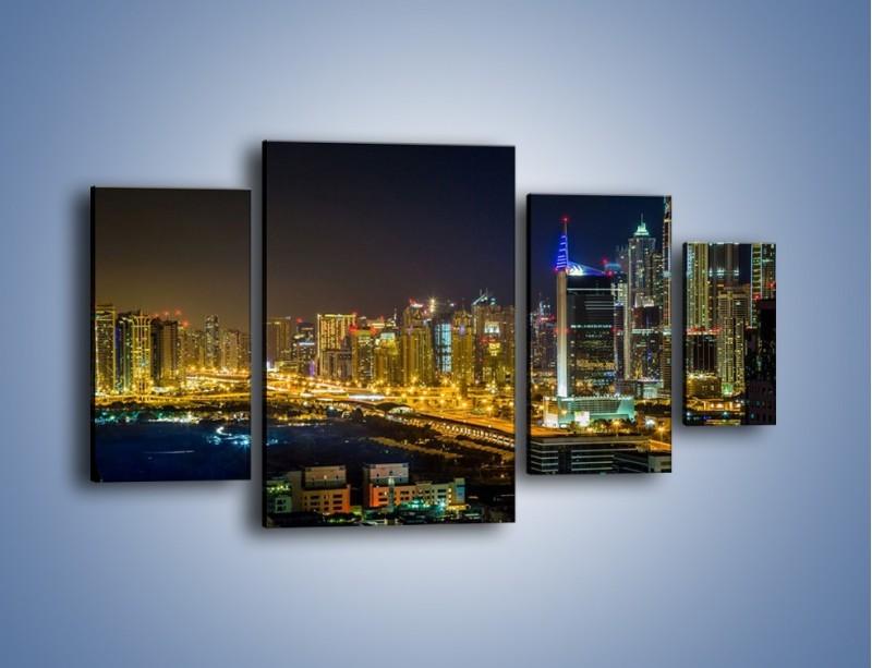 Obraz na płótnie – Oświetlony Dubaj nocą – czteroczęściowy AM506W4