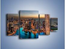 Obraz na płótnie – Centrum Dubaju wieczorową porą – czteroczęściowy AM656W4