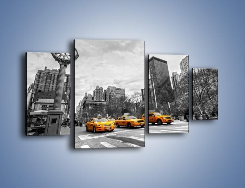 Obraz na płótnie – Żółte taksówki na szarym tle miasta – czteroczęściowy TM225W4