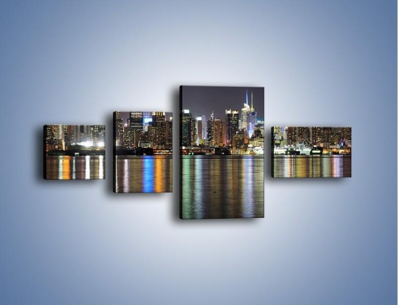 Obraz na płótnie – Światła miasta w lustrzanym odbiciu wody – czteroczęściowy AM222W5