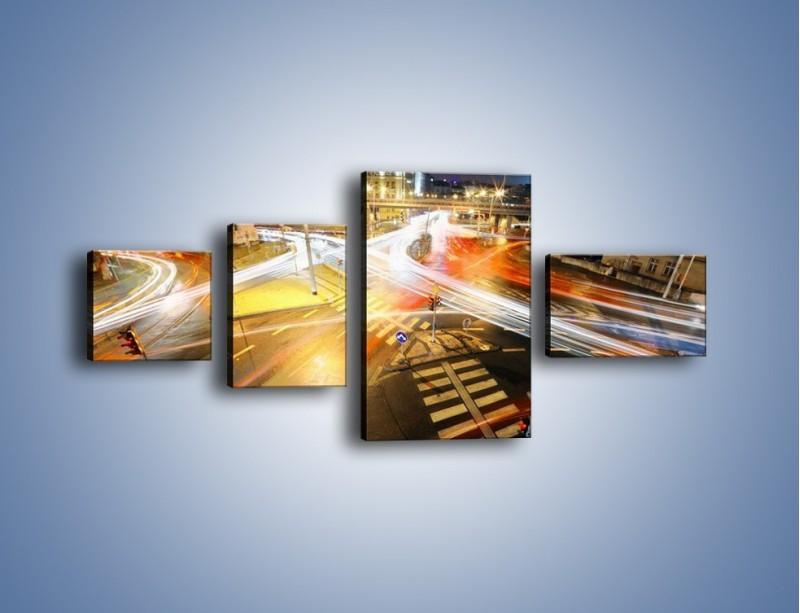 Obraz na płótnie – Światła samochodów w ruchu na skrzyżowaniu – czteroczęściowy AM279W5