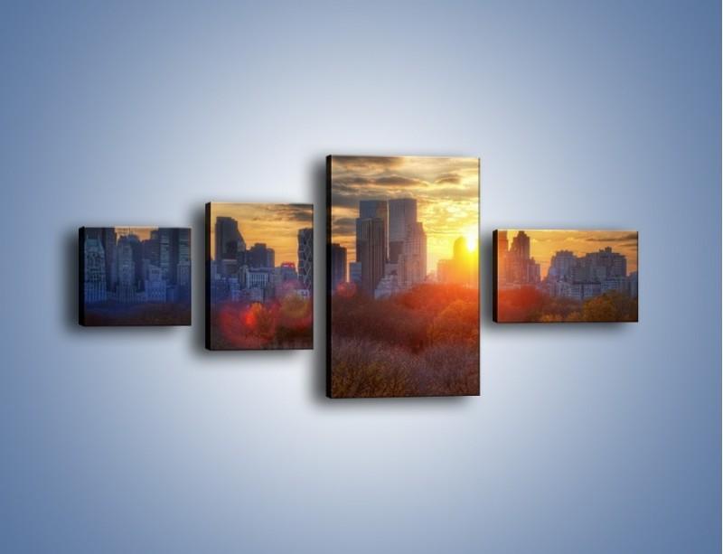 Obraz na płótnie – Wschód słońca nad miastem – czteroczęściowy AM318W5