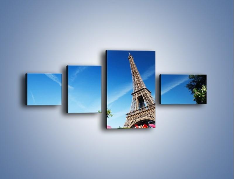 Obraz na płótnie – Wieża Eiffla pod błękitnym niebem – czteroczęściowy AM379W5