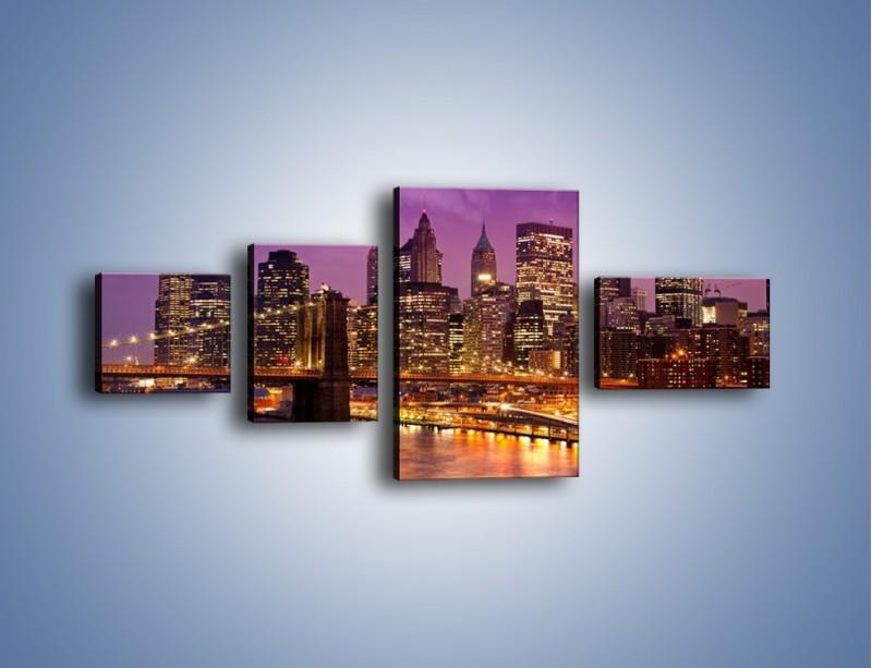 Obraz na płótnie – Nowy York pod fioletowym niebem – czteroczęściowy AM434W5
