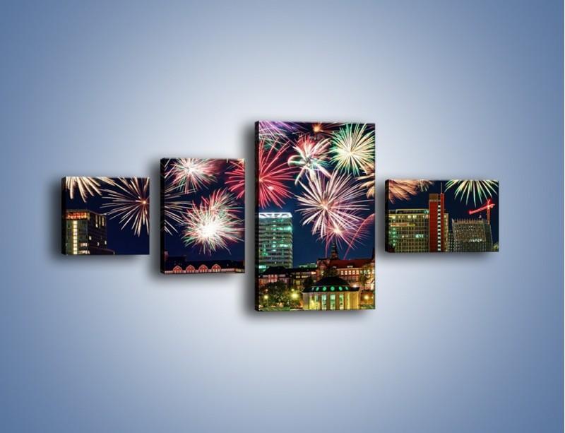 Obraz na płótnie – Noworoczne fajerwerki nad miastem – czteroczęściowy AM452W5