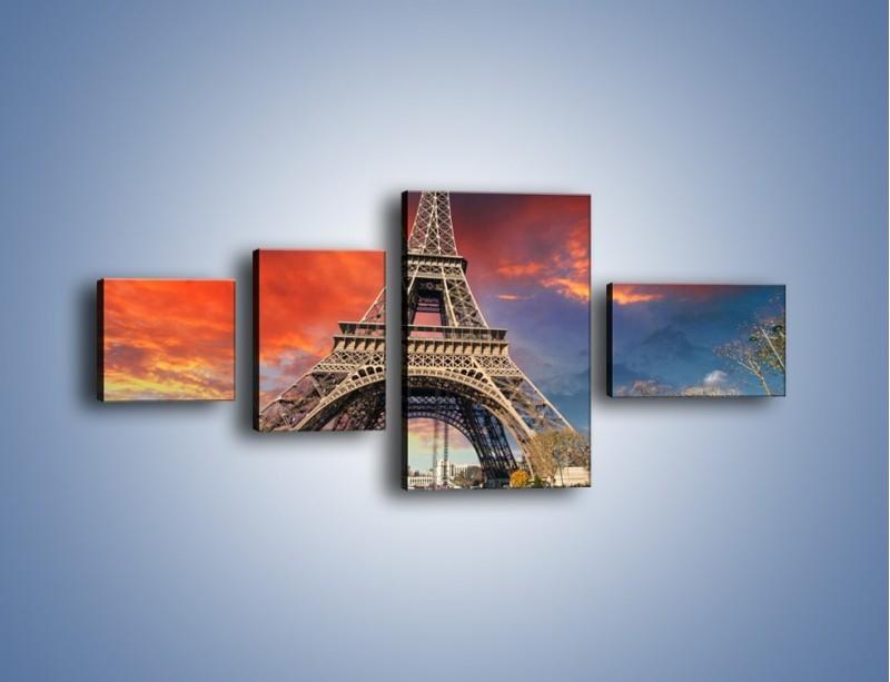 Obraz na płótnie – Wieża Eiffla pod niebiesko-czerwonym niebem – czteroczęściowy AM463W5