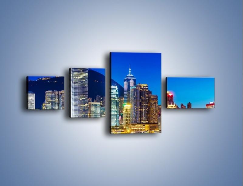 Obraz na płótnie – Oświetlone wieżowce Hong Kongu – czteroczęściowy AM498W5