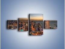 Obraz na płótnie – Centrum Dubaju wieczorową porą – czteroczęściowy AM656W5
