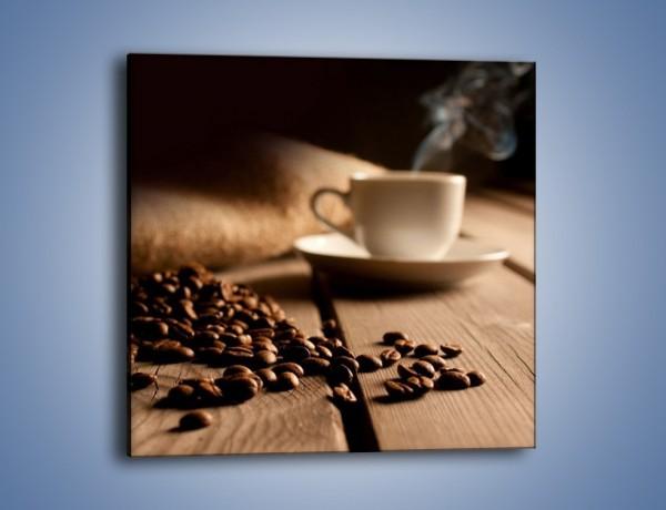 Obraz na płótnie – Ziarna kawy na drewnianym stole – jednoczęściowy kwadratowy JN457