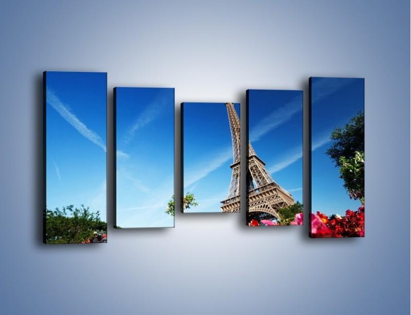 Obraz na płótnie – Wieża Eiffla pod błękitnym niebem – pięcioczęściowy AM379W2