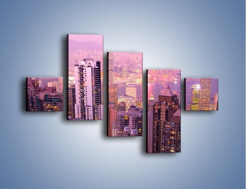 Obraz na płótnie – Duże miasto budzące się o poranku do życia – pięcioczęściowy AM062W3