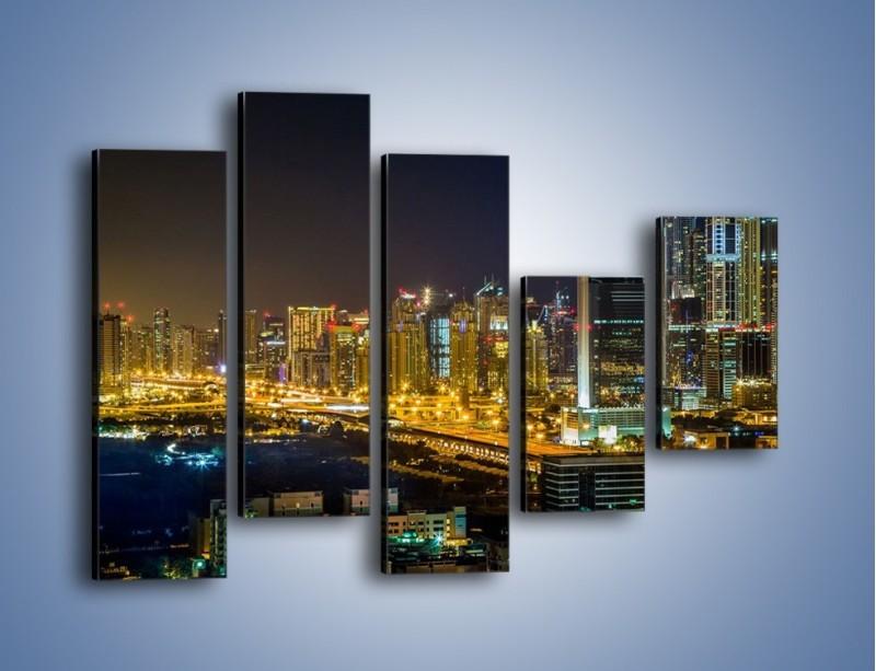 Obraz na płótnie – Oświetlony Dubaj nocą – pięcioczęściowy AM506W4