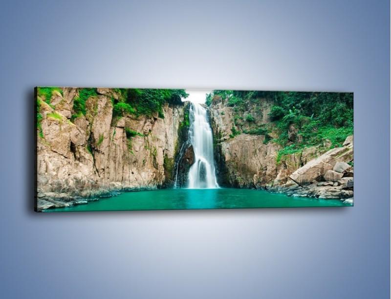 Obraz na płótnie – Skok ze skarpy do wody – jednoczęściowy panoramiczny KN1184A