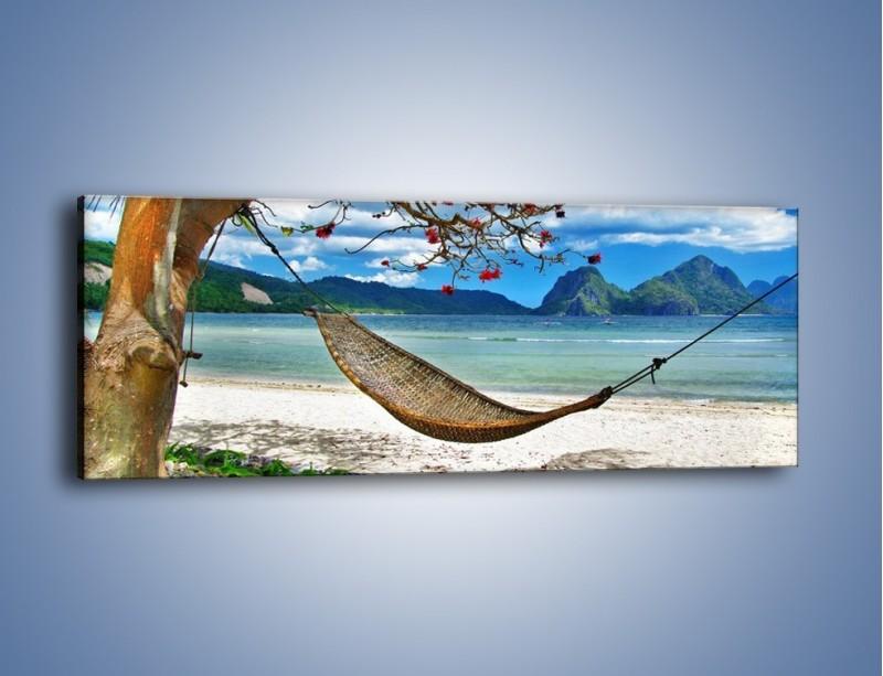 Obraz na płótnie – A może by odpocząć na hamaku? – jednoczęściowy panoramiczny KN1199A