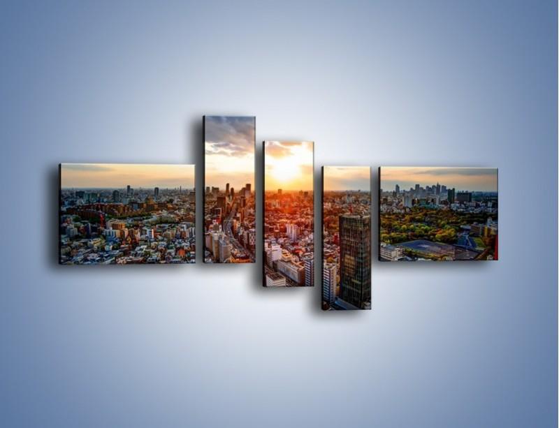 Obraz na płótnie – Panorama miasta o zachodzie słońca – pięcioczęściowy AM587W5