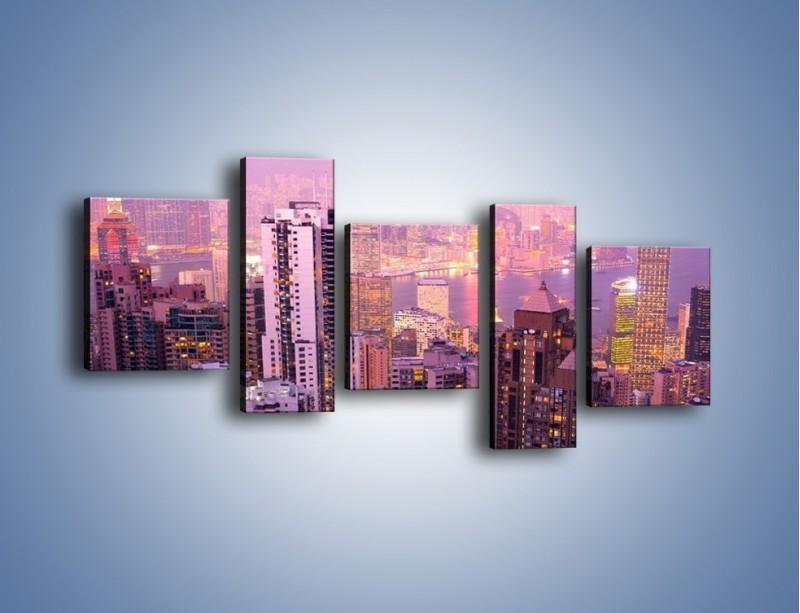 Obraz na płótnie – Duże miasto budzące się o poranku do życia – pięcioczęściowy AM062W7