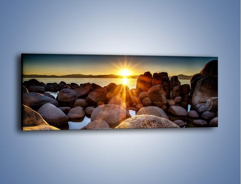 Obraz na płótnie – Kamienna wyspa w słońcu – jednoczęściowy panoramiczny KN888