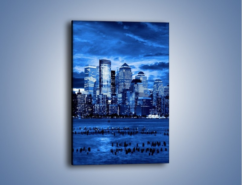 Obraz na płótnie – Wieżowce w odcieniach niebieskiego – jednoczęściowy prostokątny pionowy AM017