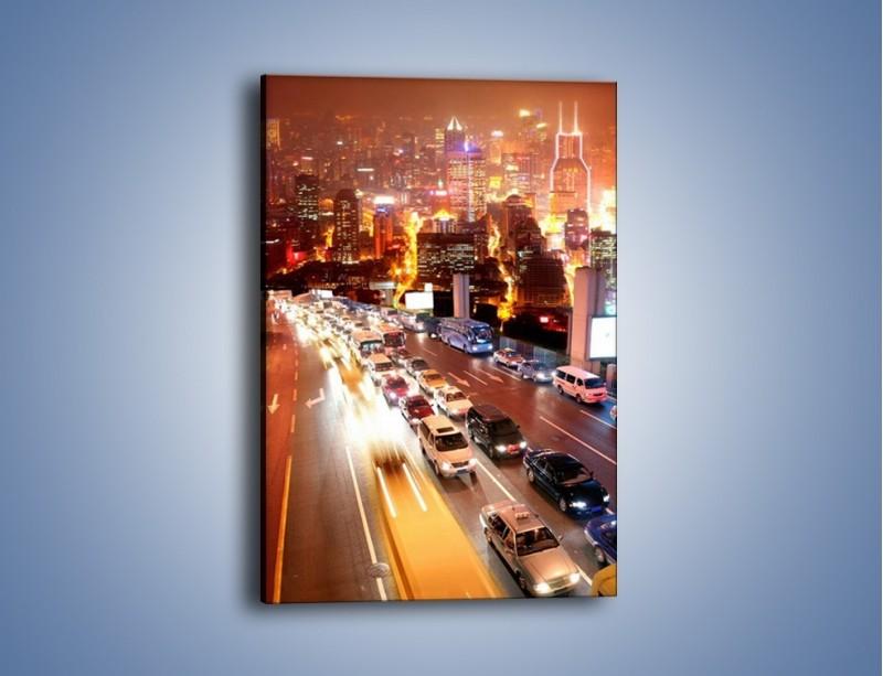 Obraz na płótnie – Wyjazd z zatłoczonego miasta – jednoczęściowy prostokątny pionowy AM080