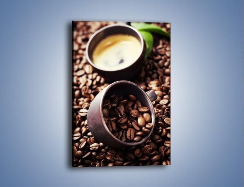 Obraz na płótnie – Kawa na rozsypanych ziarnach – jednoczęściowy prostokątny pionowy JN389