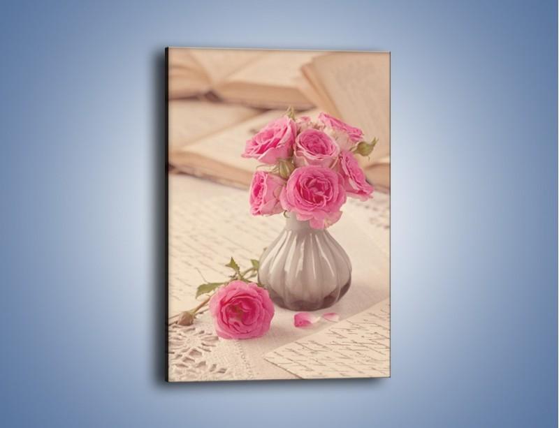 Obraz na płótnie – Ciekawa książka z różyczkami – jednoczęściowy prostokątny pionowy K697