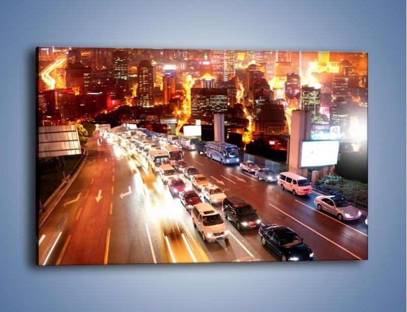 Obraz na płótnie – Wyjazd z zatłoczonego miasta – jednoczęściowy prostokątny poziomy AM080