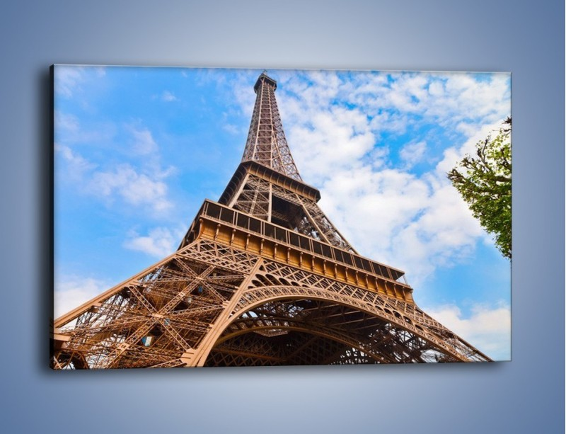 Obraz na płótnie – Wieża Eiffla pod chmurkami – jednoczęściowy prostokątny poziomy AM173