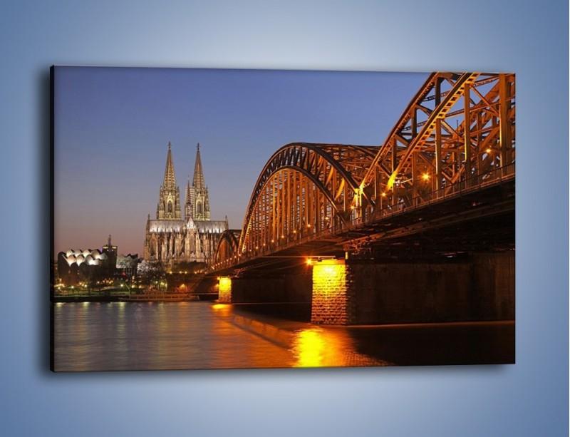 Obraz na płótnie – Most na tle kościoła – jednoczęściowy prostokątny poziomy AM186