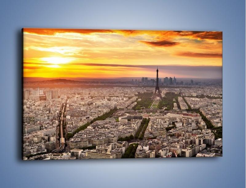 Obraz na płótnie – Zachód słońca nad Paryżem – jednoczęściowy prostokątny poziomy AM420