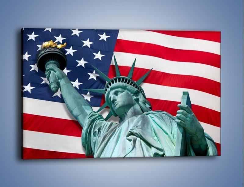 Obraz na płótnie – Statua Wolności na tle flagi USA – jednoczęściowy prostokątny poziomy AM435