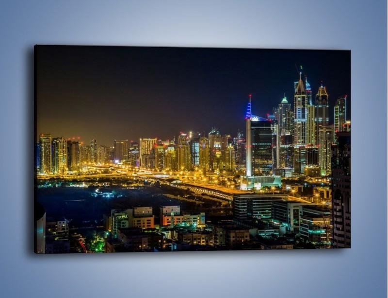 Obraz na płótnie – Oświetlony Dubaj nocą – jednoczęściowy prostokątny poziomy AM506