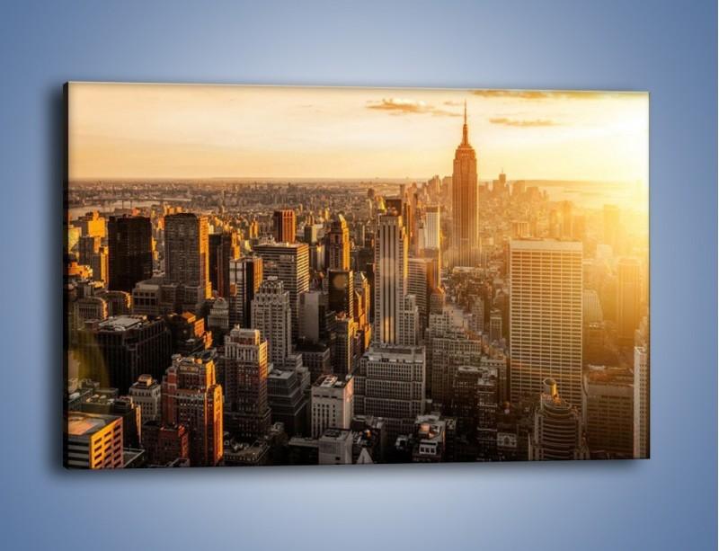 Obraz na płótnie – Zachód słońca nad Nowym Jorkiem – jednoczęściowy prostokątny poziomy AM550