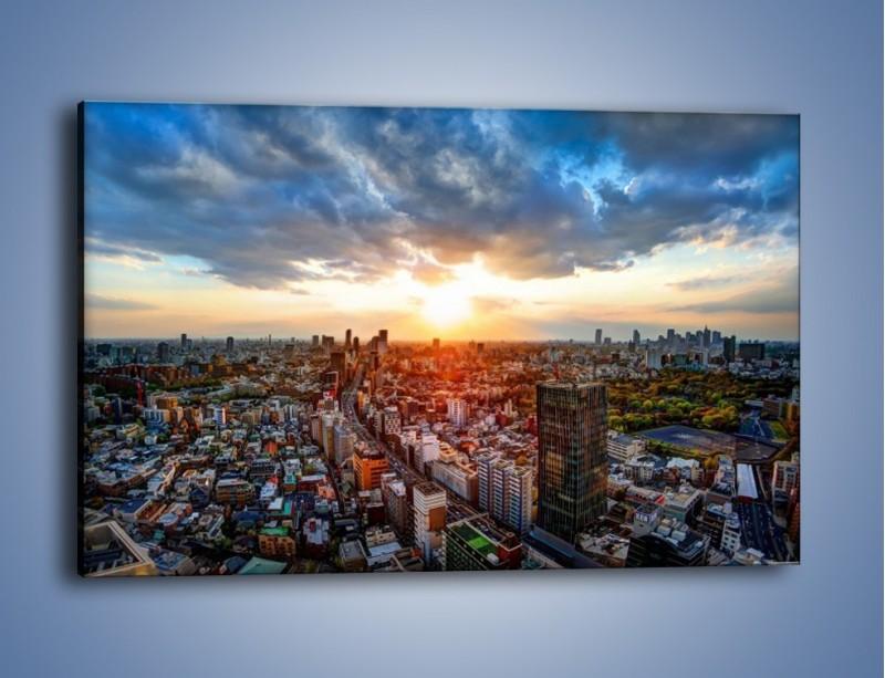 Obraz na płótnie – Panorama miasta o zachodzie słońca – jednoczęściowy prostokątny poziomy AM587