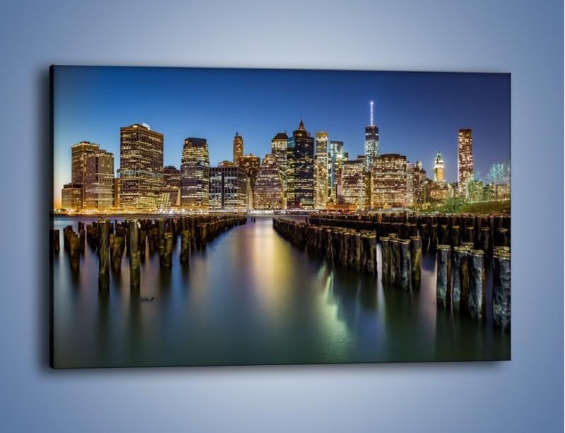 Obraz na płótnie – Zniszczone molo i widok na Manhattan – jednoczęściowy prostokątny poziomy AM601