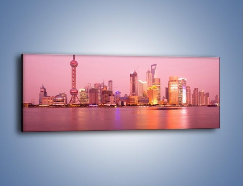 Obraz na płótnie – Miasto o poranku w odcieniach różu – jednoczęściowy panoramiczny AM020