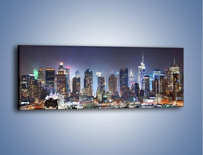 Obraz na płótnie – Oświetlone miasto nocą – jednoczęściowy panoramiczny AM034