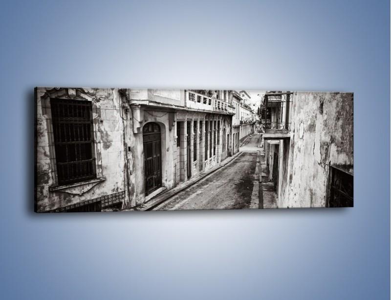 Obraz na płótnie – Urokliwa uliczka w starej części miasta – jednoczęściowy panoramiczny AM124