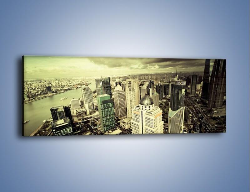 Obraz na płótnie – Ciemne chmury nad miastem – jednoczęściowy panoramiczny AM130