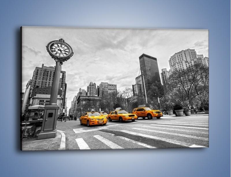 Obraz na płótnie – Żółte taksówki na szarym tle miasta – jednoczęściowy prostokątny poziomy TM225
