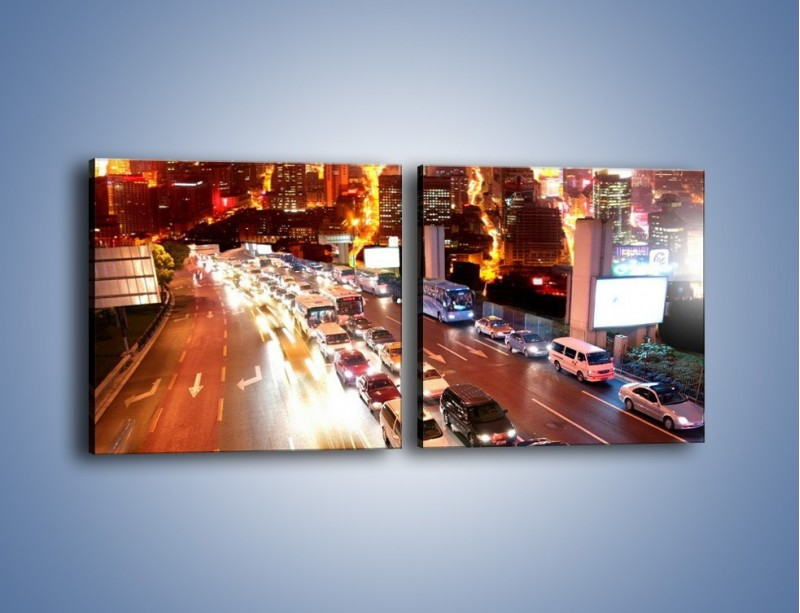 Obraz na płótnie – Wyjazd z zatłoczonego miasta – dwuczęściowy kwadratowy poziomy AM080