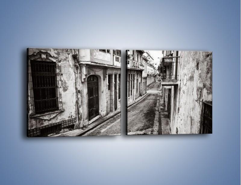 Obraz na płótnie – Urokliwa uliczka w starej części miasta – dwuczęściowy kwadratowy poziomy AM124