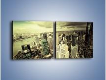 Obraz na płótnie – Ciemne chmury nad miastem – dwuczęściowy kwadratowy poziomy AM130