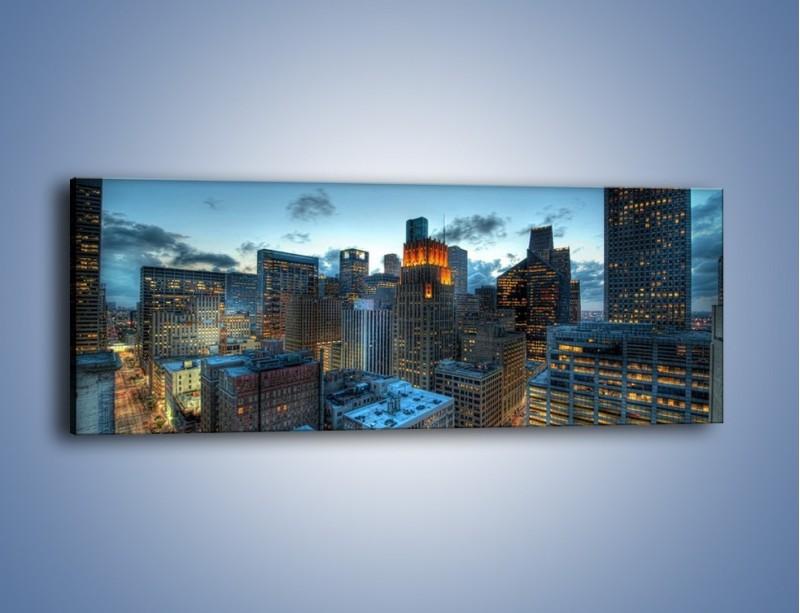 Obraz na płótnie – Drapacze chmur wczesnym wieczorem – jednoczęściowy panoramiczny AM315