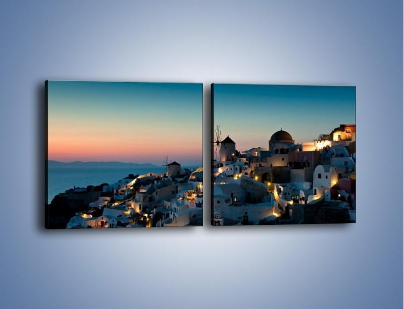 Obraz na płótnie – Domki na Santorini po zmierzchu – dwuczęściowy kwadratowy poziomy AM421
