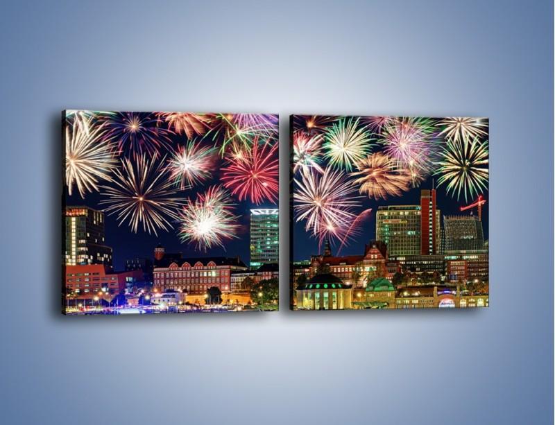 Obraz na płótnie – Noworoczne fajerwerki nad miastem – dwuczęściowy kwadratowy poziomy AM452