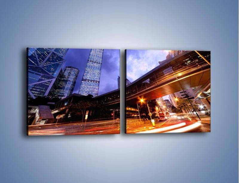Obraz na płótnie – Drapacze chmur i wieczorny ruch uliczny – dwuczęściowy kwadratowy poziomy AM487