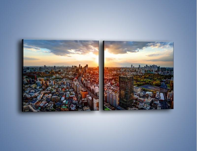 Obraz na płótnie – Panorama miasta o zachodzie słońca – dwuczęściowy kwadratowy poziomy AM587